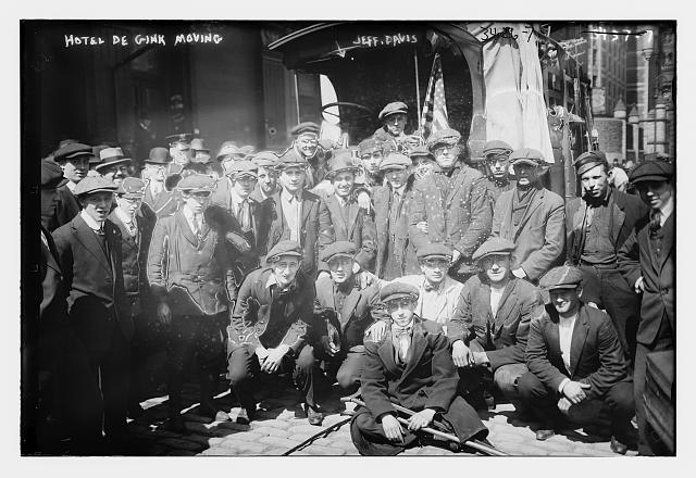 Jeff Davis and his hoboes, seated outside of New York's Hotel De Gink in 1915. (Photo: Bain News Service, courtesy of the Library of Congress Prints and Photography Division)